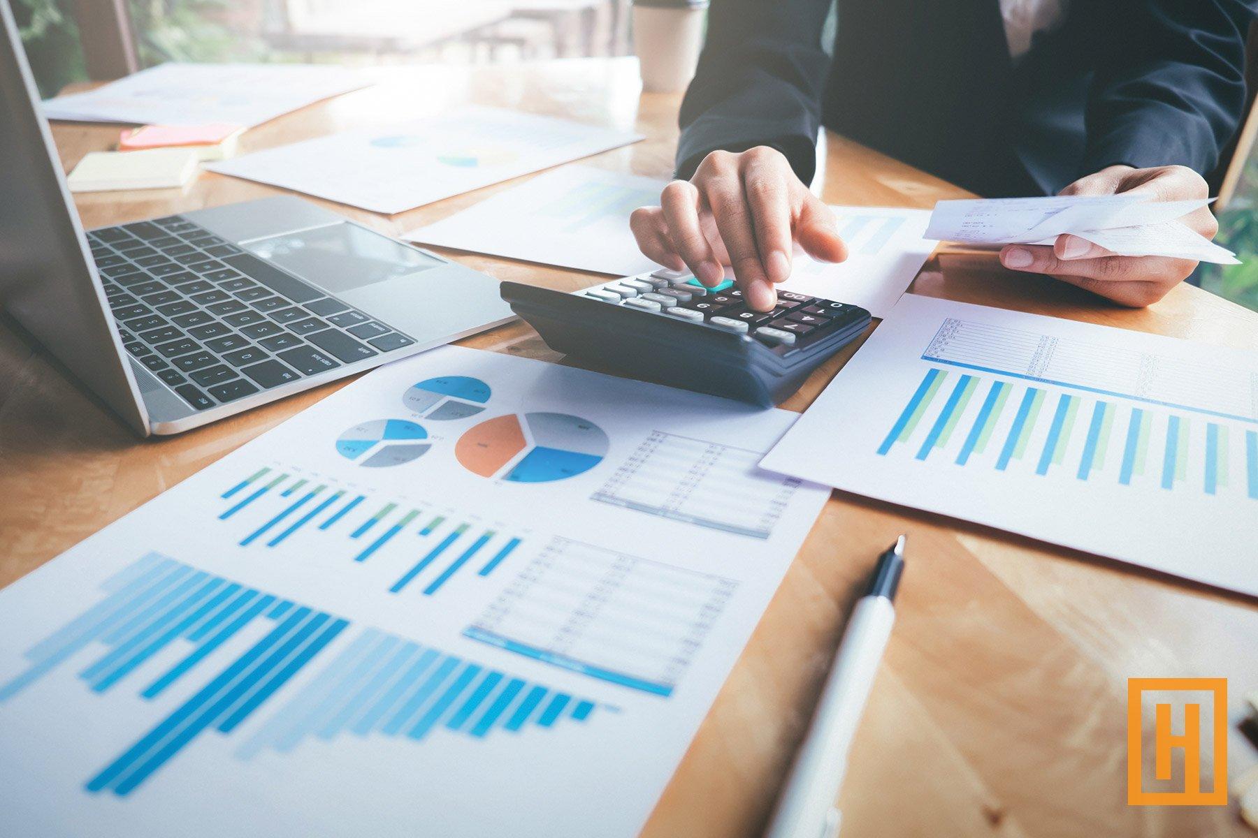 Financial investor using calculator